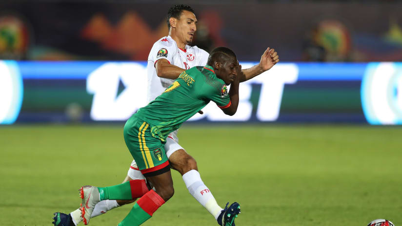 Ismael Diakite of Mauritania tackled by Karim Aouadhi of Tunisia during the 2019 Africa Cup of Nations Finals football match between Mauritania and Tunisia at the Suez Stadium, Suez, Egypt on 02 July 2019 ©Gavin Barker/BackpagePix