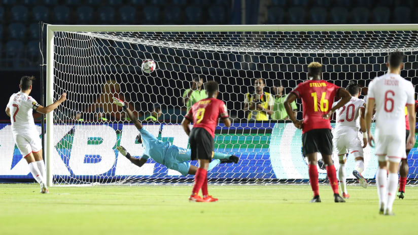 Youssef Msakni of Tunisia score a penalty pass Toni Cabaca of Angola during the 2019 Africa Cup of Nations Finals football match between Tunisia and Angola at Suez Army Stadium, Suez, Egypt on 24 June 2019 ©Samuel Shivambu/BackpagePix