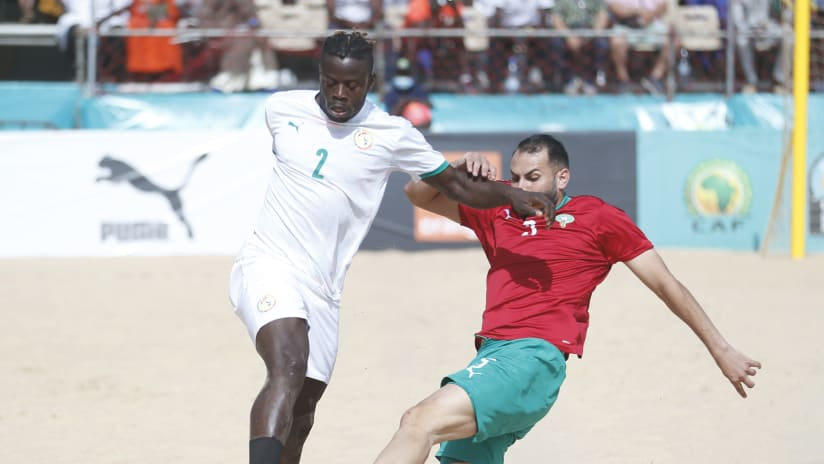 Ninou Diatta of Senegal Ninou Diatta of Senegal Mohamed Ghailani of Morocco during the 2021 Beach Soccer African Cup of Nations Semi Final game between Senegal and Morocco Thies, Saly in Senegal on 28 May 2021 ©