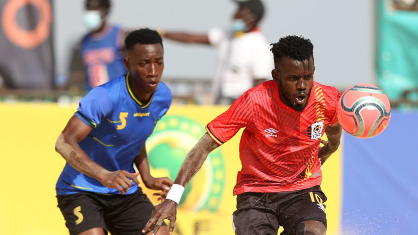 Baker Lukooya of Uganda challenged by Eric Constantin Manyama of Tanzania during the 2021 Beach Soccer African Cup of Nations game between Tanzania and Uganda in Thies, Saly in Senegal on 24 May 2021 © Alain Suff