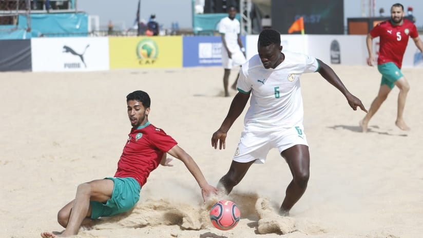 Mamadou Sylla of Senegal challenged by Zouhair Jabbary of Morocco during the 2021 Beach Soccer African Cup of Nations Semi Final game between Senegal and Morocco Thies, Saly in Senegal on 28 May 2021 © Alain Suff