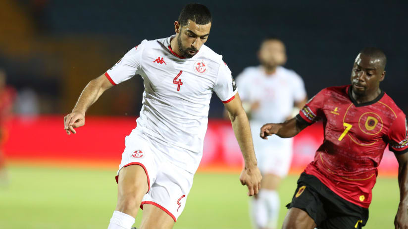 Yassine Merriah of Tunisia challenged by Djalma Campos of Angola during the 2019 Africa Cup of Nations Finals football match between Tunisia and Angola at Suez Army Stadium, Suez, Egypt on 24 June 2019 ©Samuel Shivambu/BackpagePix
