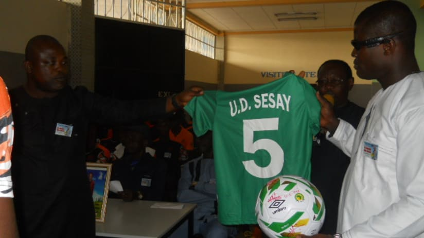 SLFA presenting retired no5 jersey to Din's son (Wilson's)