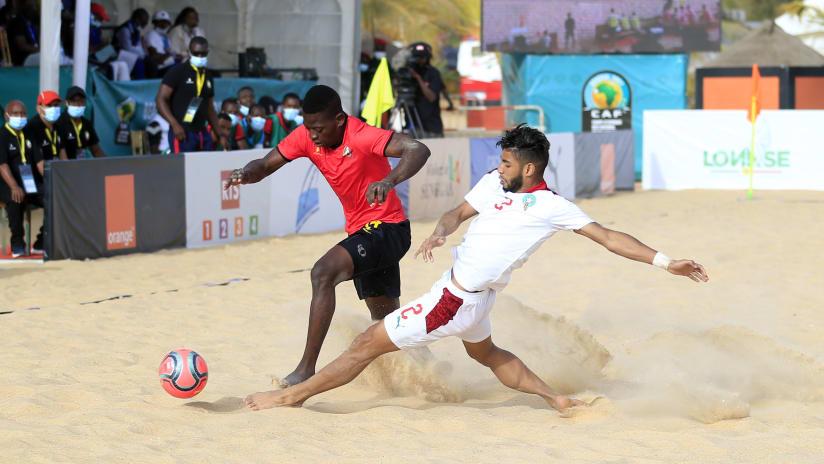 Julio Armando Manjate of Mozambique challenged by Houcine Fanchy of Morocco during the 2021 Beach Soccer African Cup of Nations game between Mozambique and Morocco in Thies, Saly in Senegal on 25 May 2021 © Alain