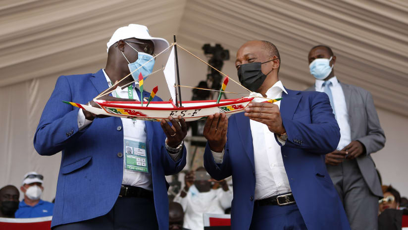 Senegal FA President Augustin Senghor and Caf President Patrice Motsepe exchange gifts before the 2021 Beach Soccer African Cup of Nations Final between Senegal and Mozambique in Thies, Saly in Senegal on 29 May