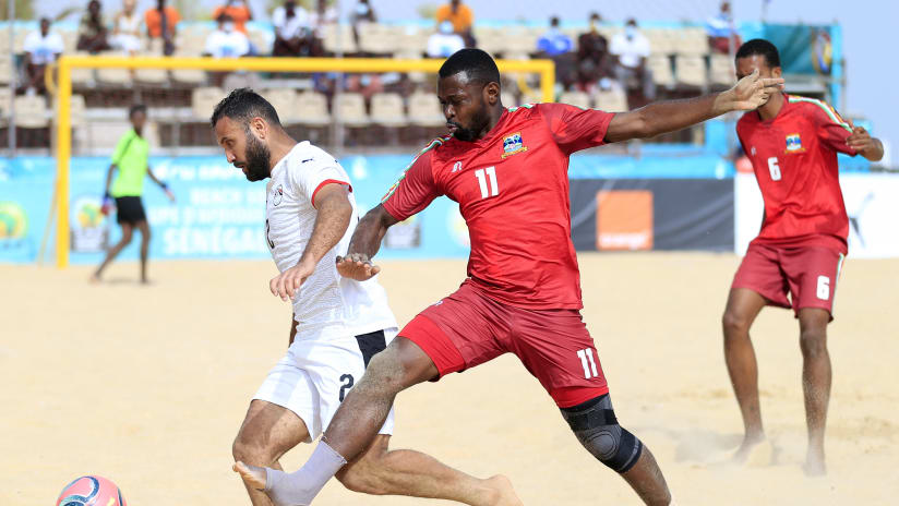 Hassane Hussein of Egypt challenged by Hansel the Lionheart of Seychelles during the 2021 Beach Soccer African Cup of Nations game between Seychelles and Egypt in Thies, Saly in Senegal on 25 May 2021 © Alain Suf