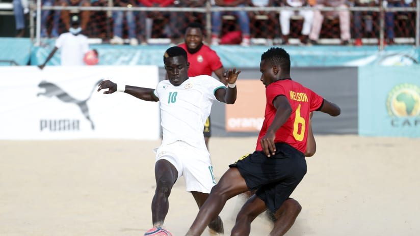 Mamou Diagne of Senegal is tackled by Nelson Manuel of Mozambique during the 2021 Beach Soccer African Cup of Nations Final between Senegal and Mozambique in Thies, Saly in Senegal on 29 May 2021 © Alain SuffoBac