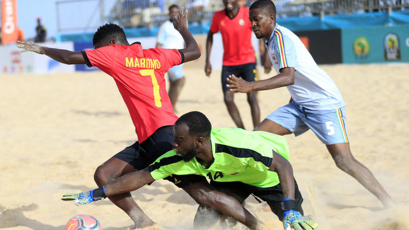 Helio Filipe Mahota of Mozambique tackled by Davis Leon of Seychelles during the 2021 Beach Soccer African Cup of Nations game between Mozambique and Seychelles in Thies, Saly in Senegal on 24 May 2021 © Alain Su