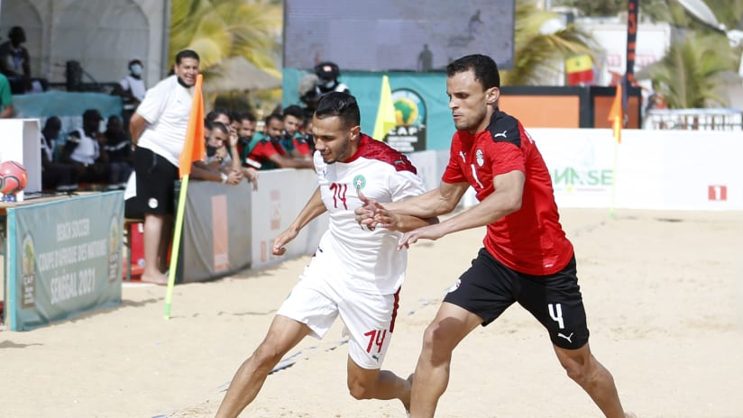 Driss Ghannam of Morocco challenged by Ahmed Mohamed of Egypt during the 2021 Beach Soccer African Cup of Nations game between Egypt and Morocco in Thies, Saly in Senegal on 26 May 2021 © Alain SuffoBackpagePix