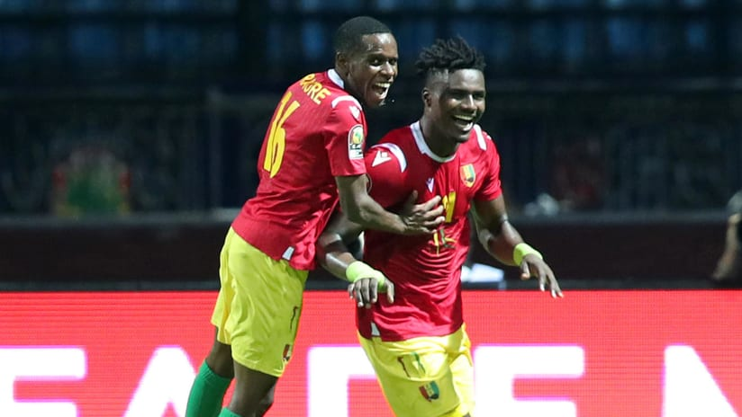 Sory Kaba (r) celebrates goal with teammate Ibrahima Traore of Guinea during the 2019 Africa Cup of Nations Finals match between Guinea and Madagascar at the Alexandria Stadium, Alexandria on the 22 June 2019 ©Muzi Ntombela/BackpagePix