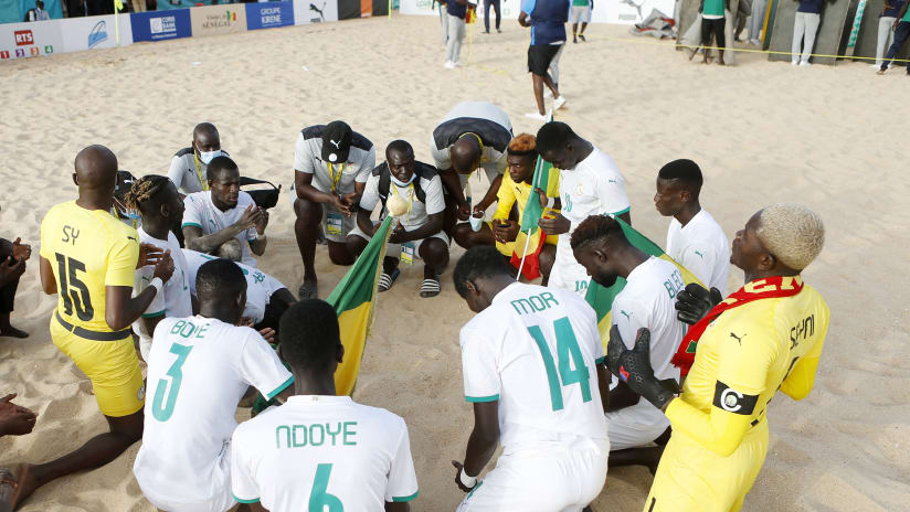 Senegal squad gives thanks in prayer after victory in the 2021 Beach Soccer African Cup of Nations Final between Senegal and Mozambique in Thies, Saly in Senegal on 29 May 2021 © Alain SuffoBackpagePix