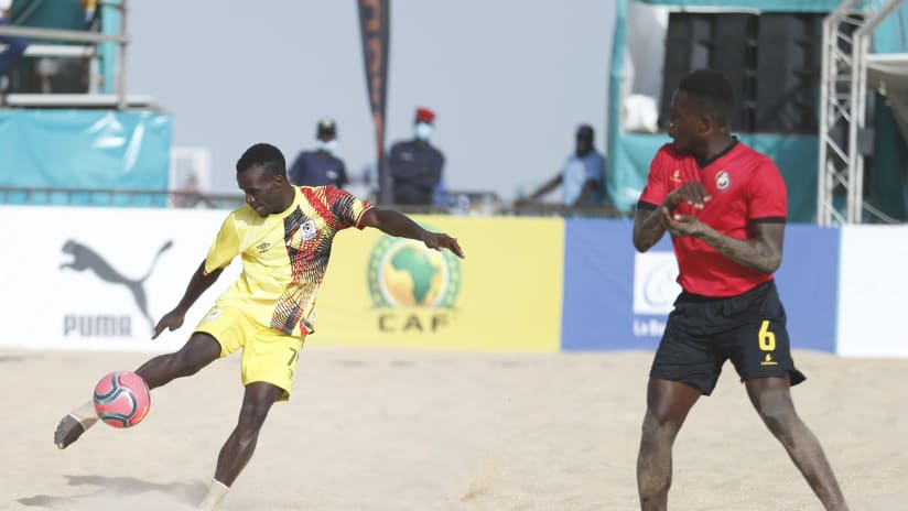 Douglas Muganga of Uganda challenged by Nelson Manuel of Mozambique during the 2021 Beach Soccer African Cup of Nations Semi Final game between Mozambique and Uganda Thies, Saly in Senegal on 28 May 2021 © Alain