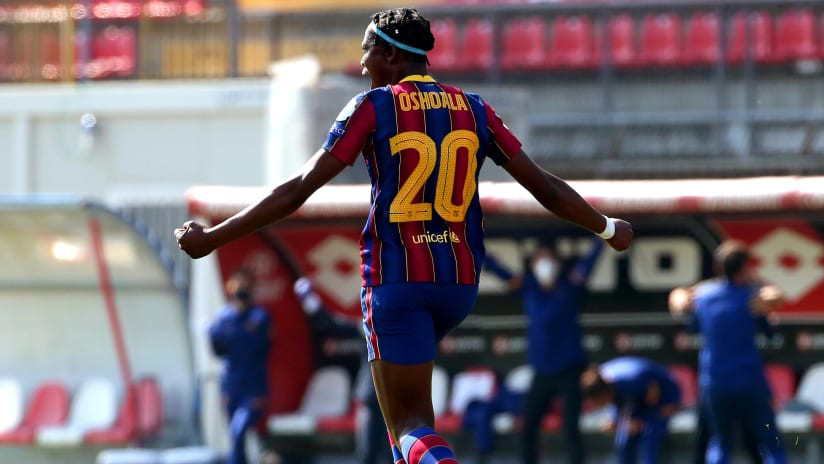 Barcelona's Asisat Oshoala celebrates after scoring the 1-0 lead during the UEFA Women's Champions League quarter final, first leg soccer match between FC Barcelona and Manchester City