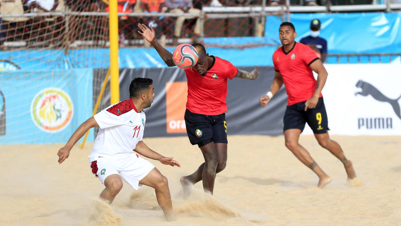 Gerson Vicente Chivale of Mozambique challenged by Kamal El Mahrouk of Morocco during the 2021 Beach Soccer African Cup of Nations game between Mozambique and Morocco in Thies, Saly in Senegal on 25 May 2021 © Al