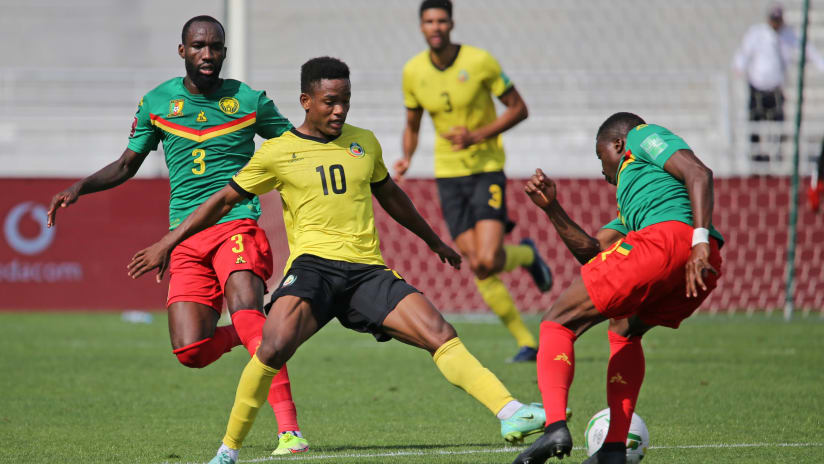 Nouhou Tolo of Cameroon is challenged by Geny Catamo of Mozambique during the Qatar 2022 FIFA World Cup Qualifier between Mozambique and Cameroon at Grand Stade De Tanger in Morocco on 11 October 2021 ©BackpagePi