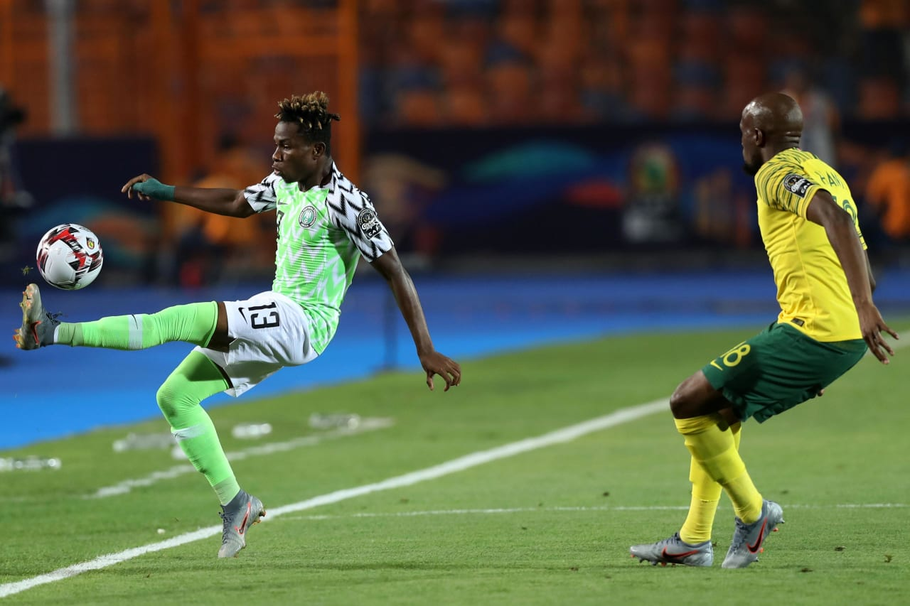Samuel Chukwueze of Nigeria challenged by Sifiso Hlanti of South Africa during the 2019 Africa Cup of Nations Finals, quarterfinals match between Nigeria and South Africa at Cairo International Stadium, Cairo, Egypt on 10 July 2019 ©Samuel Shivambu/BackpagePix