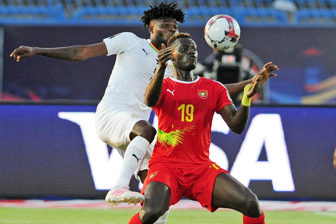 Joseph Mendes of Guinea-Bissau is challenged by Thomas Teye Partey of Ghana during the 2019 Africa Cup of Nations Finals football match between Guinea Bissau and Ghana at the Suez Stadium, Suez, Egypt on 02 July 2019 © Ryan Wilkisky/BackpagePix