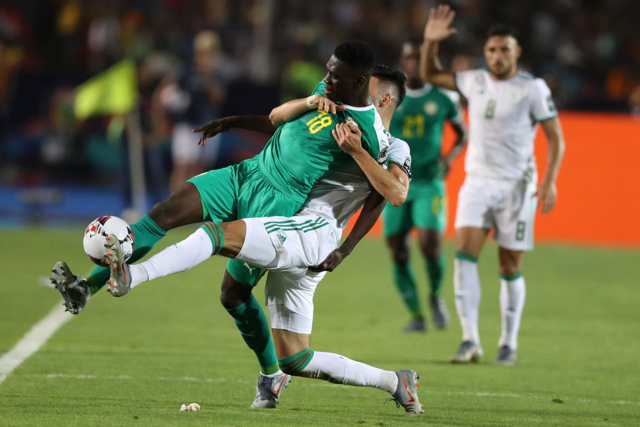 Ismaila Sarr of Senegal tackled by Rami Bensebaini of Algeria during the 2019 Africa Cup of Nations Finals, Final match between Senegal and Algeria at Cairo International Stadium, Cairo, Egypt on 19 July 2019 ©Samuel Shivambu/BackpagePix