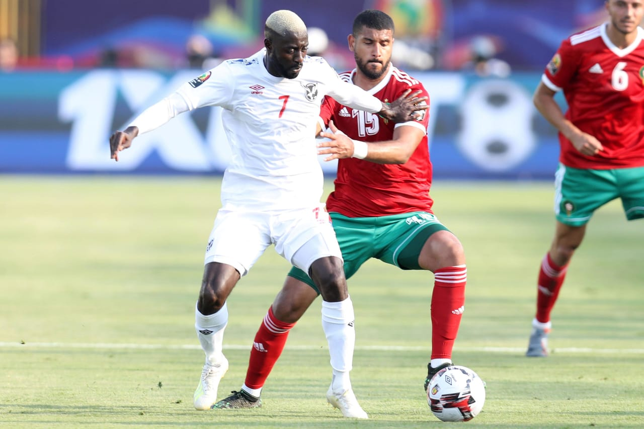Deon Hotto of Namibia challenged by Youssef Ait Bennasser  of Morocco during the 2019 Africa Cup of Nations Finals match between Morocco and Namibia at Training at Al-Salaam Stadium, Cairo, Egypt on 23 June 2019 ©Samuel Shivambu/BackpagePix