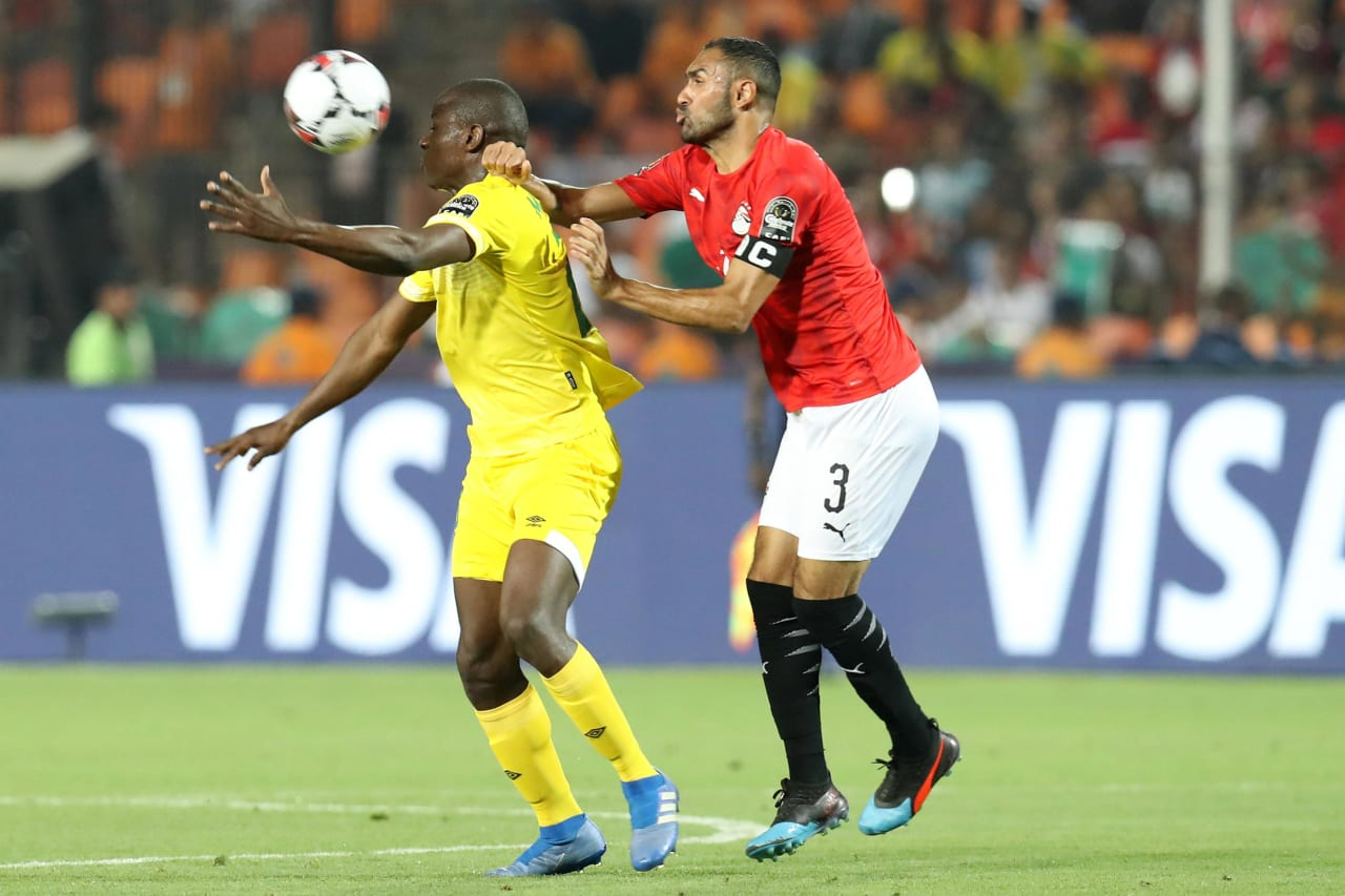 Nyasha Mushekwi of Zimbabwe challenged by Ahmed El Mohamady of Egypt during the 2019 Africa Cup of Nations Finals match between Egypt and Zimbabwe at Cairo International Stadium, Cairo, Egypt on 21 June 2019 ©Samuel Shivambu/BackpagePix
