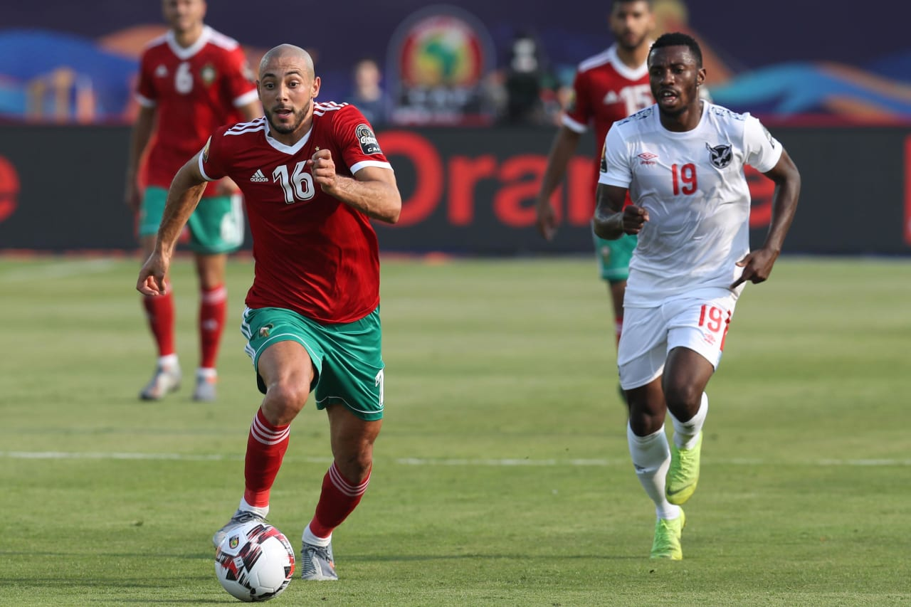 Nordin Amrabat of Morocco challenged by Petrus Shitembi of Namibia during the 2019 Africa Cup of Nations Finals match between Morocco and Namibia at Training at Al-Salaam Stadium, Cairo, Egypt on 23 June 2019 ©Samuel Shivambu/BackpagePix