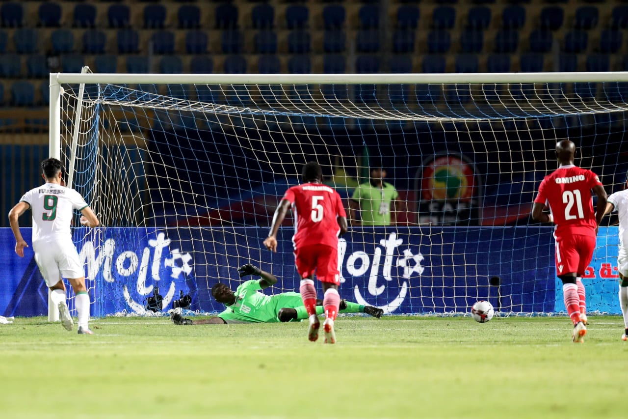 Baghdad Bounedjah of Algeria score a penalty pass Matasi Patrick of Kenya during the 2019 Africa Cup of Nations Finals football match between Algeria and Kenya at 30 June Stadium, Cairo, Egypt on 23 June 2019 ©Samuel Shivambu/BackpagePix