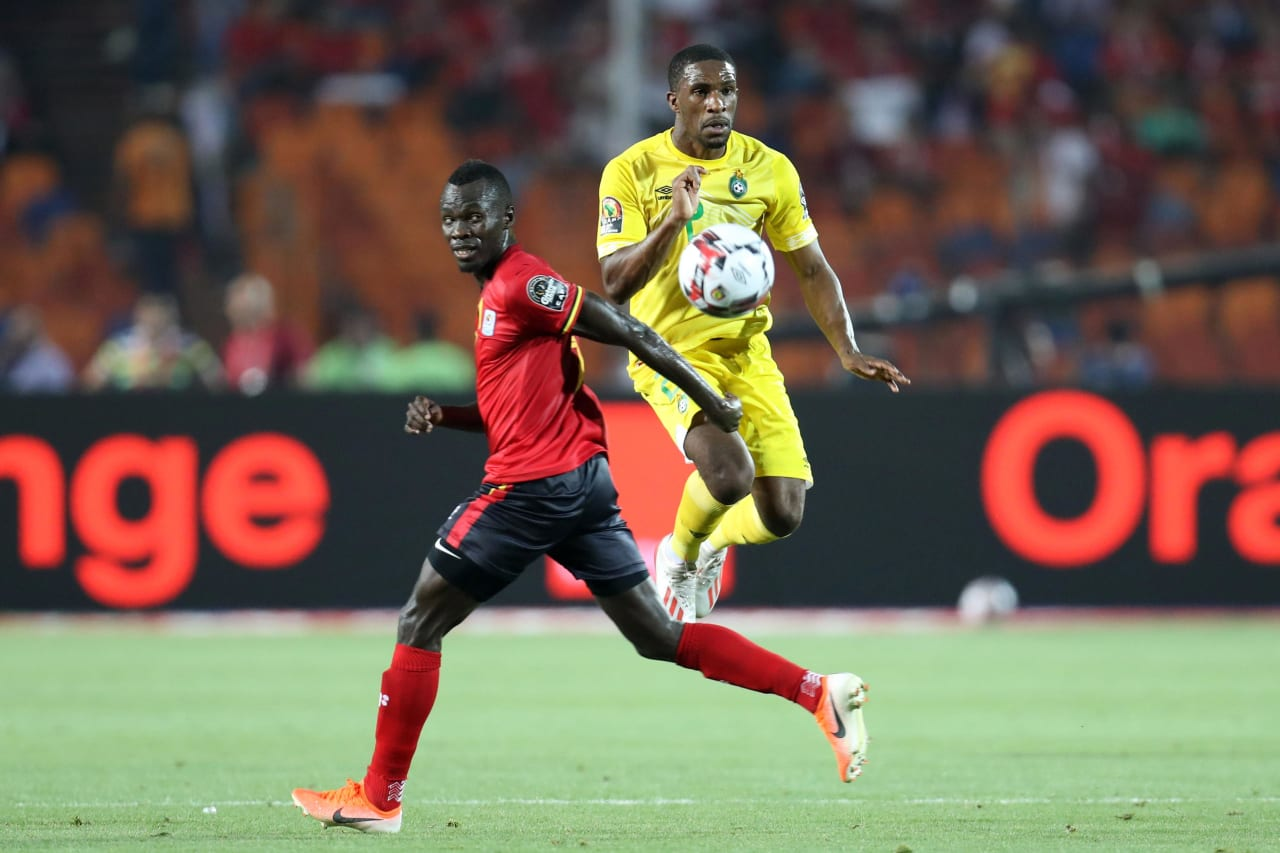 Tendayi Darikwa of Zimbabwe challenged by Emmanuel Okwi of Uganda during the 2019 Africa Cup of Nations Finals match between Uganda and Zimbabwe at Cairo International Stadium, Cairo, Egypt on 26 June 2019 ©Samuel Shivambu/BackpagePix