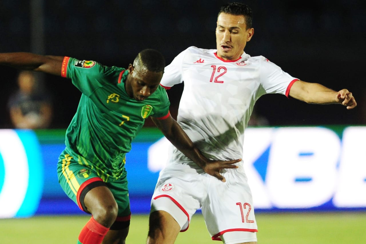 Ismael Diakite of Mauritania takes on Karim Aouadhi of Tunisia during the 2019 Africa Cup of Nations Finals football match between Mauritania and Tunisia at the Suez Stadium, Suez, Egypt on 02 July 2019 © Ryan Wilkisky/BackpagePix