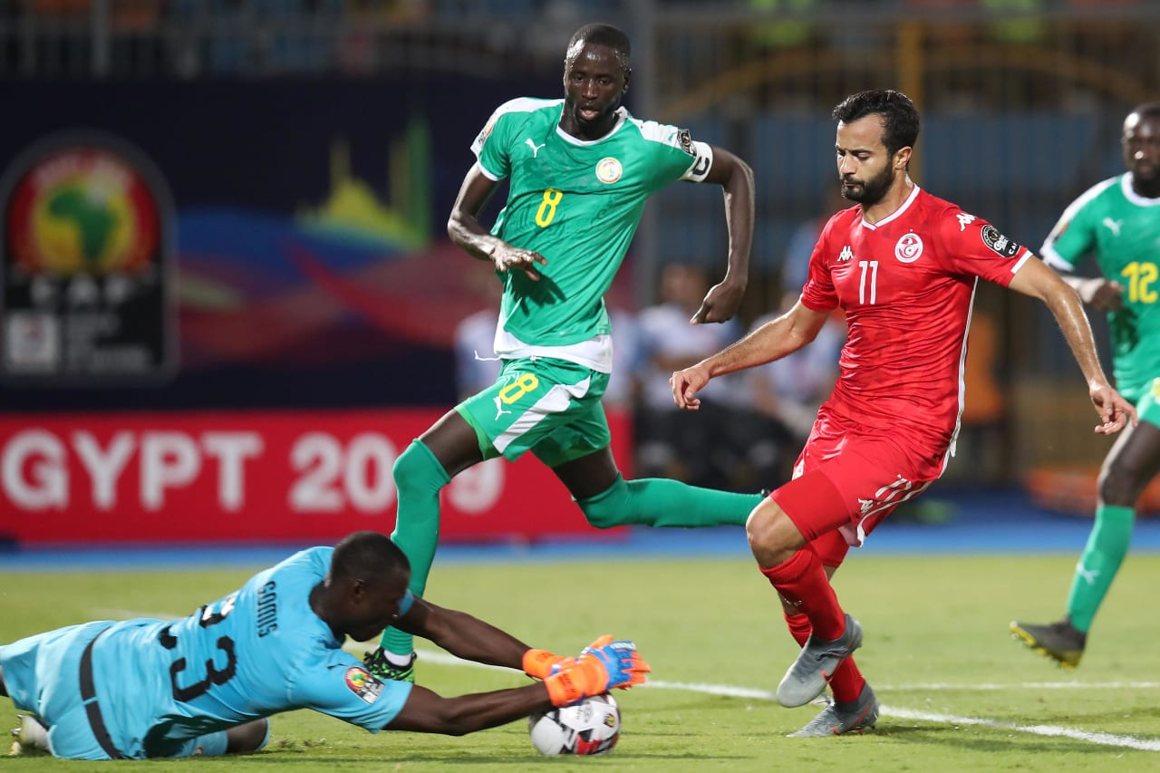 Taha Yassine Khenissi of Tunisia challenged by Alfred Gomis of Senegal during the 2019 Africa Cup of Nations Semifinals match between Senegal and Tunisia at the 30 June Stadium, Cairo on the 14 July 2019 ©Muzi Ntombela/BackpagePix
