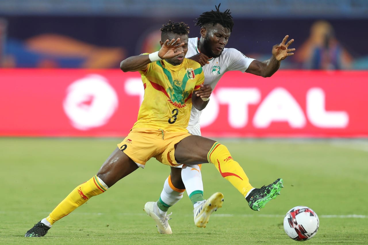 Youssou Kone of Mali challenged by Franck Kessie of Ivory Coast during the 2019 Africa Cup of Nations Finals last 16 match between Mali and Ivory Coast at Suez Stadium, Suez, Egypt on 08 July 2019 ©Samuel Shivambu/BackpagePix