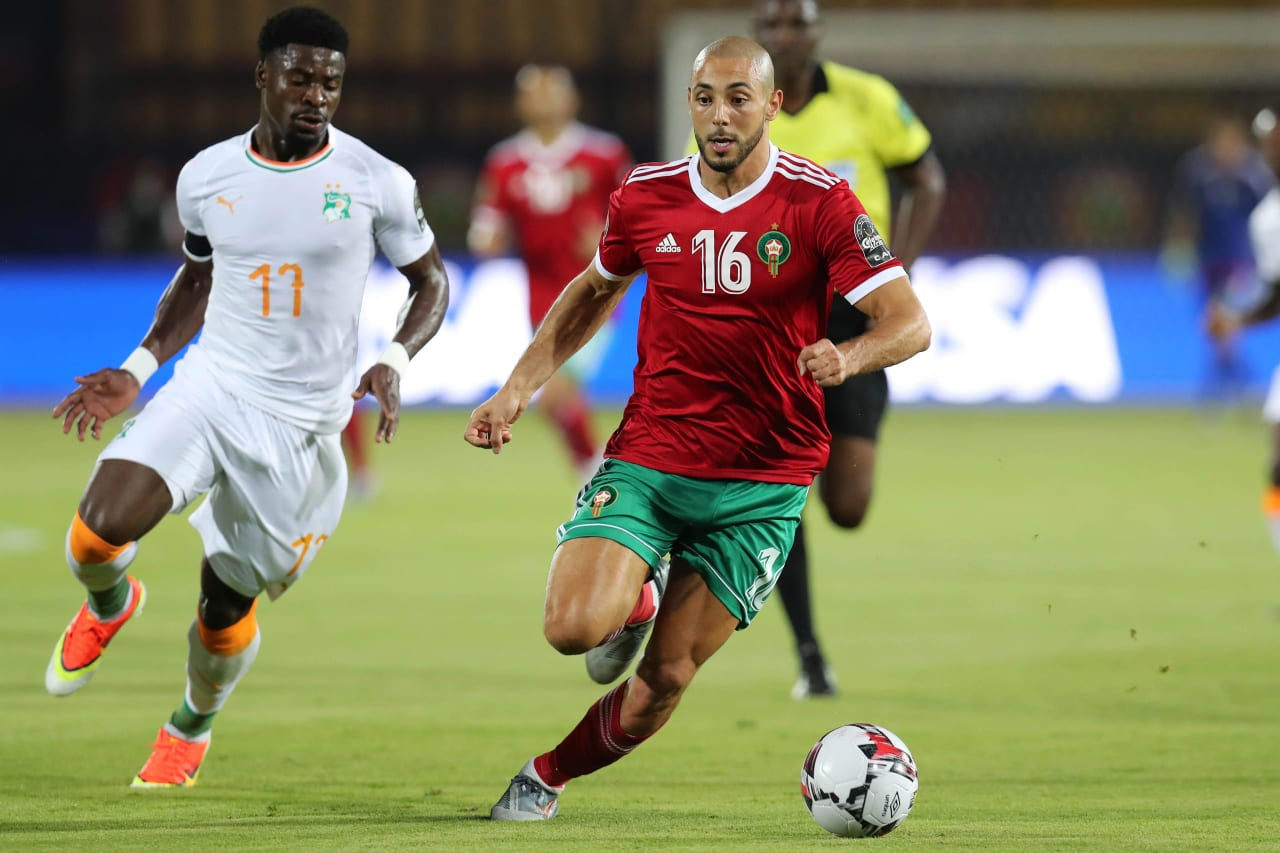 Noureddine Amrabat of Morocco evades tackle from Serge Aurier of Ivory Coast during the 2019 Africa Cup of Nations Finals football match between Morocco and Ivory Coast at the Al Salam Stadium, Cairo, Egypt on 28 June 2019 ©Gavin Barker/BackpagePix