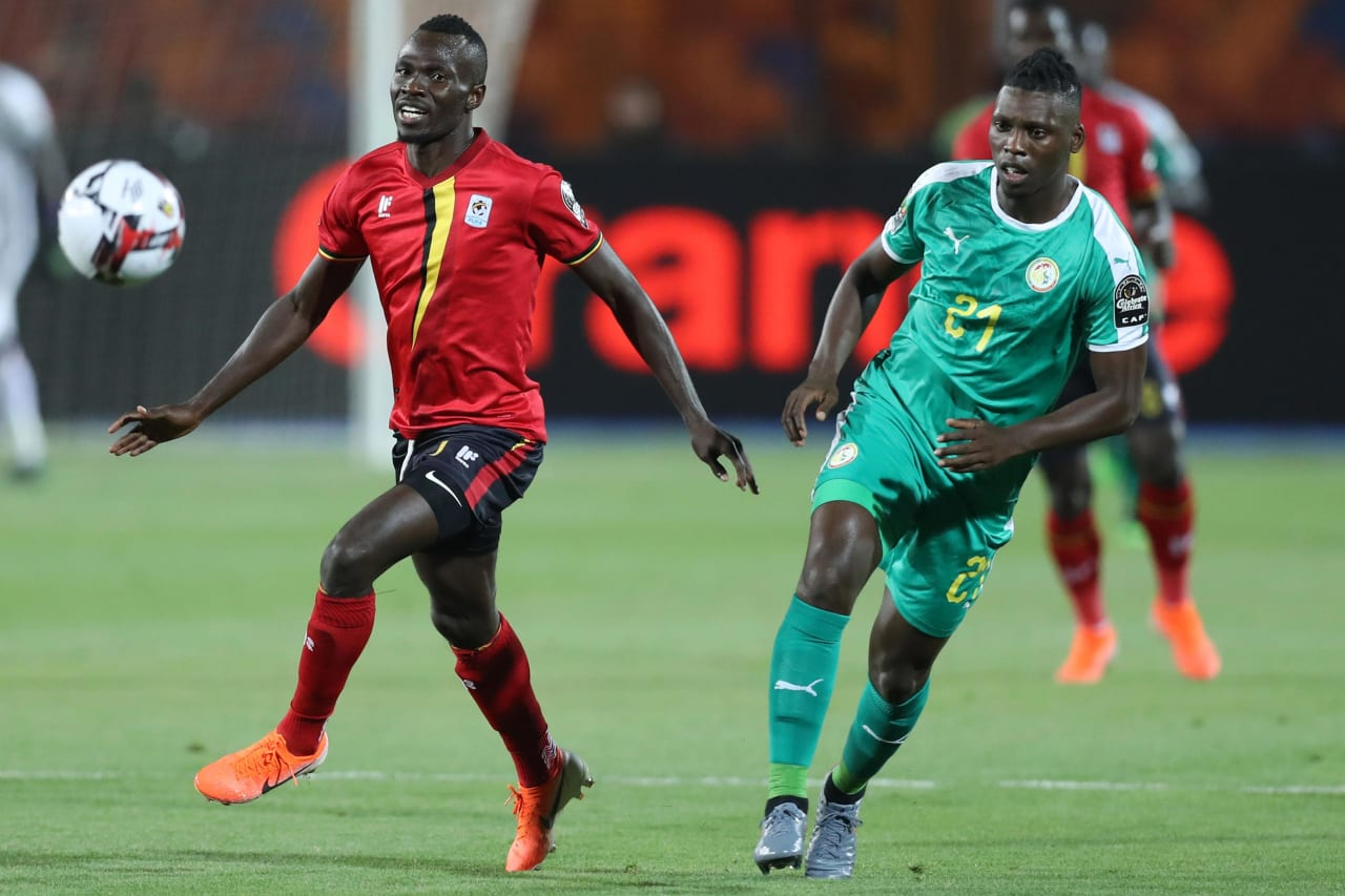 Emmanuel Okwi of Uganda challenged by Lamine Gassama of Senegal during the 2019 Africa Cup of Nations Finals last 16 match between Uganda and Senegal at Cairo International Stadium, Cairo, Egypt on 05 July 2019 ©Samuel Shivambu/BackpagePix