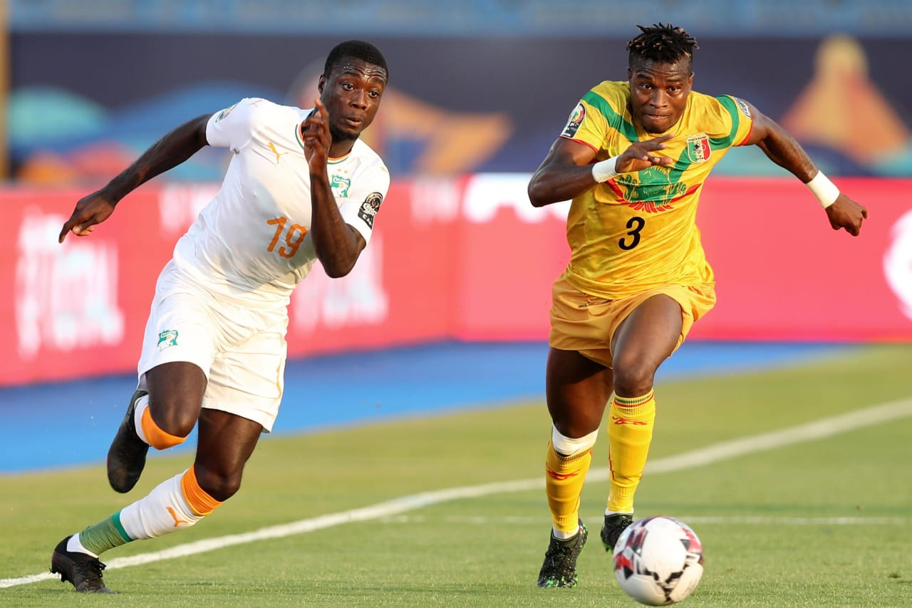 Nicolas Pepe of Ivory Coast challenged by Youssou Kone of Mali during the 2019 Africa Cup of Nations Finals last 16 match between Mali and Ivory Coast at Suez Stadium, Suez, Egypt on 08 July 2019 ©Samuel Shivambu/BackpagePix