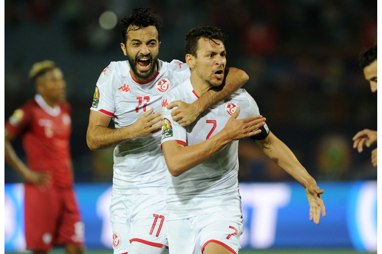 Youssef Msakni of Tunisia celebrates his goal with teammate Taha Yassine Khenissi of Tunisia during the Africa Cup of Nations 2019 Finals quarterfinal game between Madagascar and Tunisia at Al Salam Stadium in Cairo, Egypt on 11 July 2019 © Ryan Wilkisky/BackpagePix
