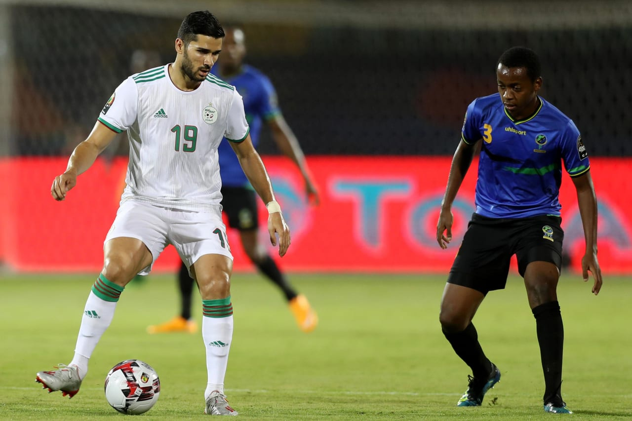 Mehdi Abeid of Algeria challenged by Feisal Salum of Tanzania during the 2019 Africa Cup of Nations Finals Tanzania and Algeria at Al Salam Stadium, Cairo, Egypt on 01 July 2019 ©Samuel Shivambu/BackpagePix