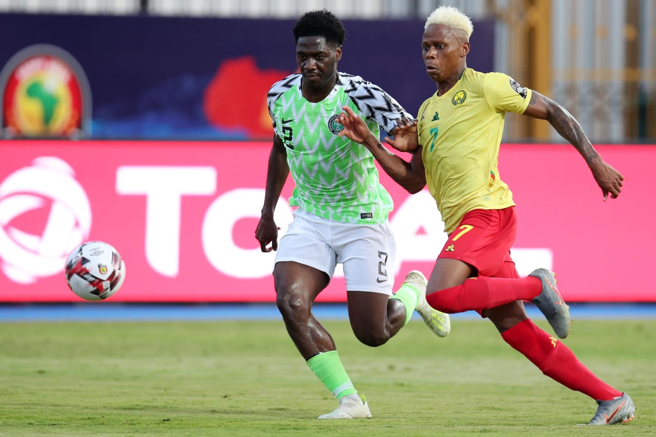 Temitayo Olufisayo Aina of Nigeria challenged by Clinton Njie of Cameroon during the 2019 Africa Cup of Nations Last 16 match between Nigeria and Cameroon at the Alexandria Stadium, Alexandria on the 06 July 2019 ©Muzi Ntombela/BackpagePix