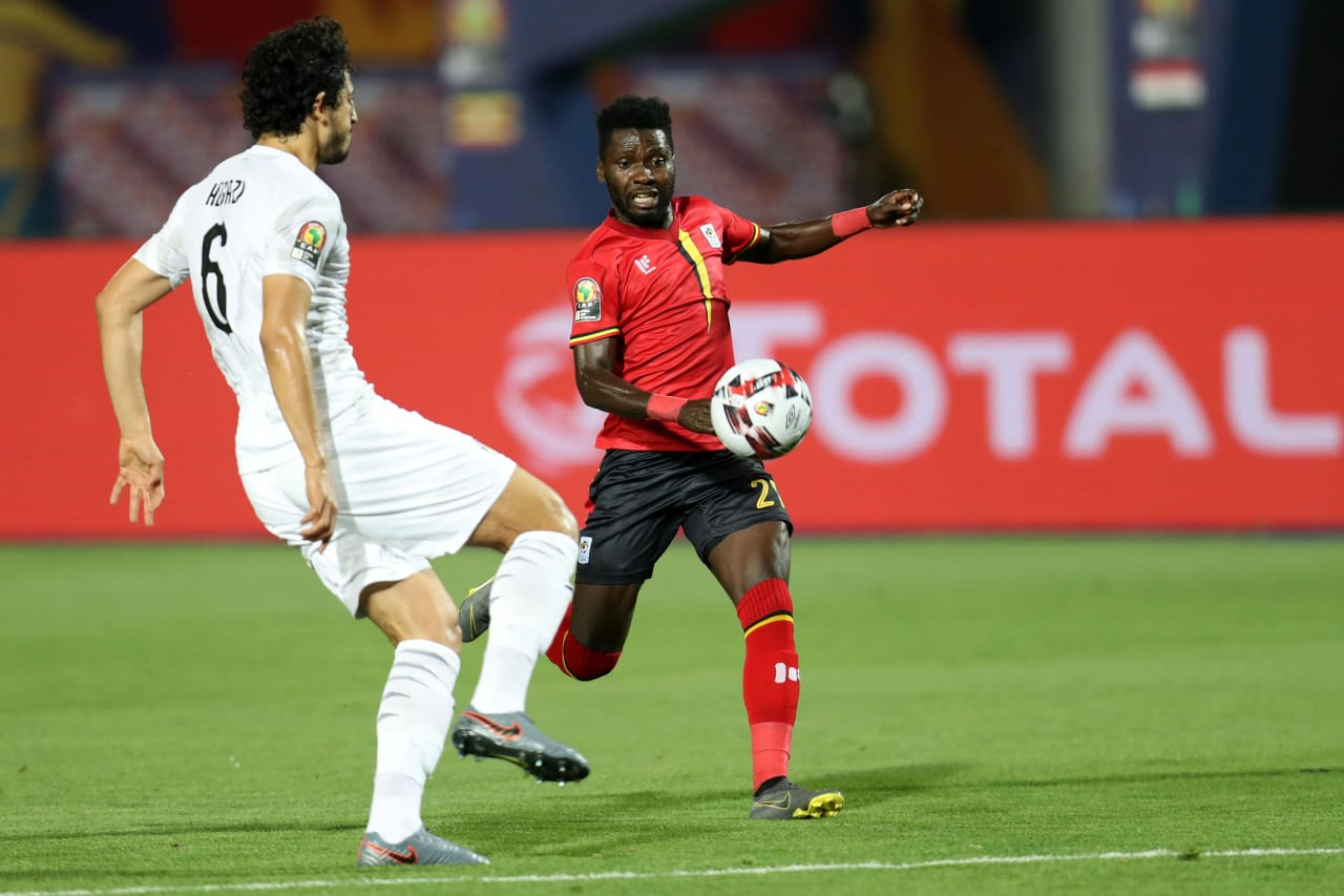 Allan Kyambadde of Uganda challenged by Ahmed Hegazi of Egypt during the 2019 Africa Cup of Nations Finals Uganda and Egypt at Cairo International Stadium, Cairo, Egypt on 30 June 2019 ©Samuel Shivambu/BackpagePix