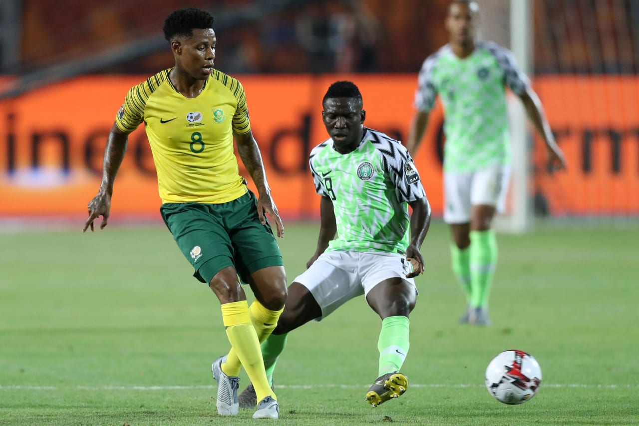 Bongani Zungu of South Africa challenged by Peter Etebo of Nigeria during the 2019 Africa Cup of Nations Finals, quarterfinals match between Nigeria and South Africa at Cairo International Stadium, Cairo, Egypt on 10 July 2019 ©Samuel Shivambu/BackpagePix