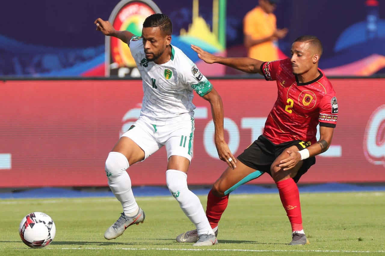 Khalil Moulaye Ahmed Bessam of Mauritania challenged by Bruno Gaspar of Angola during the 2019 Africa Cup of Nations Finals football match between Mauritania and Angola  at the Suez Stadium, Suez, Egypt on 29 June 2019 ©Gavin Barker/BackpagePix