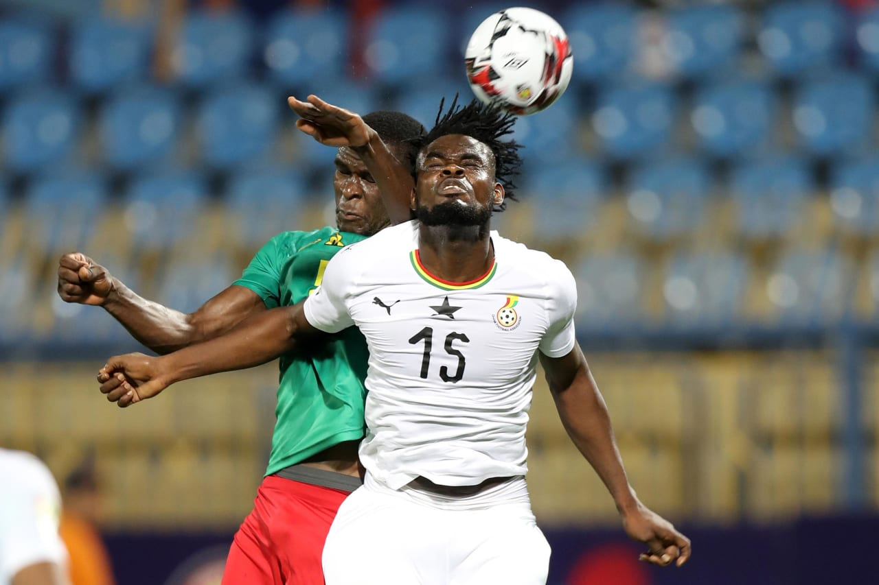 Nuhu Adams Kasim of Ghana challenged by Michael Ngadeu Ngadjui of Cameroon during the 2019 Africa Cup of Nations Finals Cameroon and Ghana at Ismailia Stadium, Ismailia, Egypt on 29 June 2019 ©Samuel Shivambu/BackpagePix