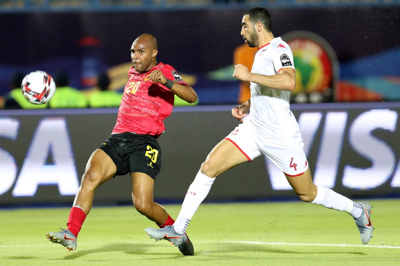 Wilson Eduardo of Angola challenged by Yassine Merriah of Tunisia during the 2019 Africa Cup of Nations Finals football match between Tunisia and Angola at Suez Army Stadium, Suez, Egypt on 24 June 2019 ©Samuel Shivambu/BackpagePix