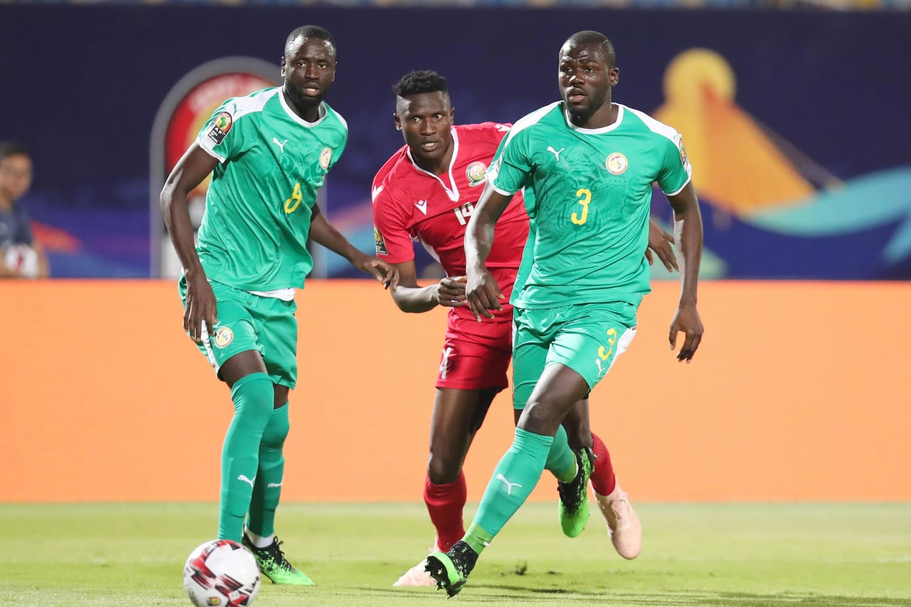 Michael Olunga of Kenya challenged by Kalidou Koulibaly (r) and Johanna Omolo of Kenya during the 2019 Africa Cup of Nations match between Kenya and Senegal at the 30 June Stadium, Cairo on the 01 July 2019 ©Muzi Ntombela/BackpagePix