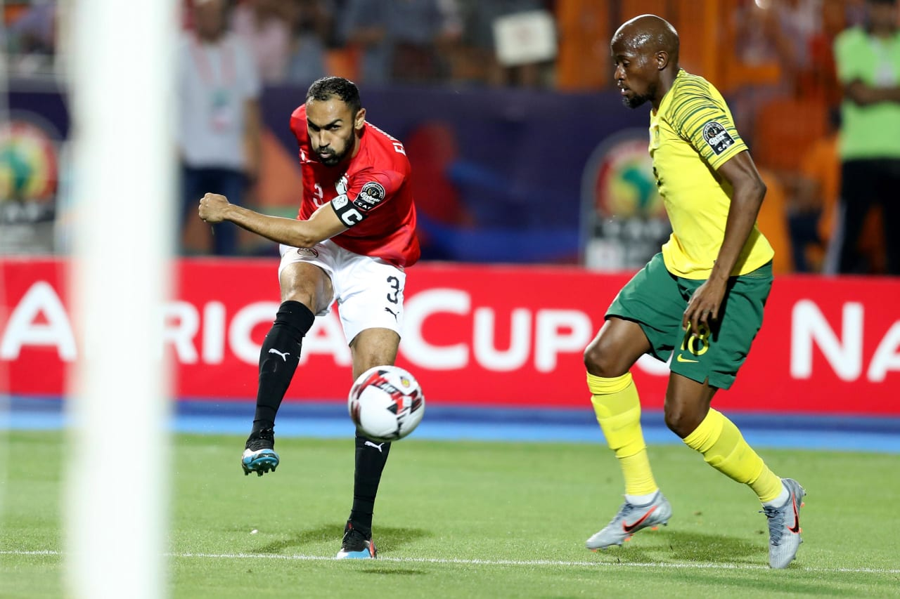 Ahmed El Mohamady of Egypt challenged by Sifiso Hlanti of South Africa during the 2019 Africa Cup of Nations Finals last 16 match between Egypt and South Africa at Cairo International Stadium, Cairo, Egypt on 06 July 2019 ©Samuel Shivambu/BackpagePix