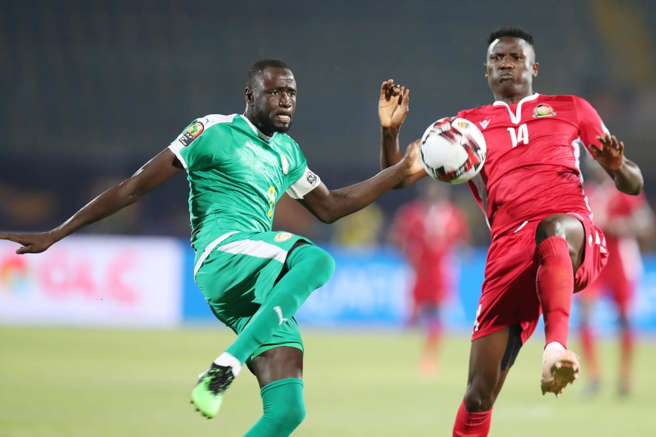 Cheikhou Kouyate of Senegal clears ball from Michael Olunga of Kenya during the 2019 Africa Cup of Nations match between Kenya and Senegal at the 30 June Stadium, Cairo on the 01 July 2019 ©Muzi Ntombela/BackpagePix