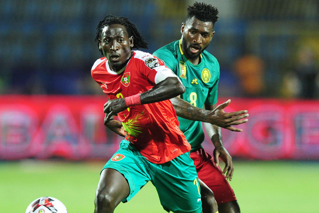 Jose Luis Mendes Lopez Zezinho of Guinea-Bissau is challenged by Andre Frank Zambo Anguissa of Cameroon during the 2019 Africa Cup of Nations Finals game between Cameroon and Guinea-Bissau at Ismailia Stadium in Ismailia, Egypt on 25 June 2019 © Ryan Wilkisky/BackpagePix