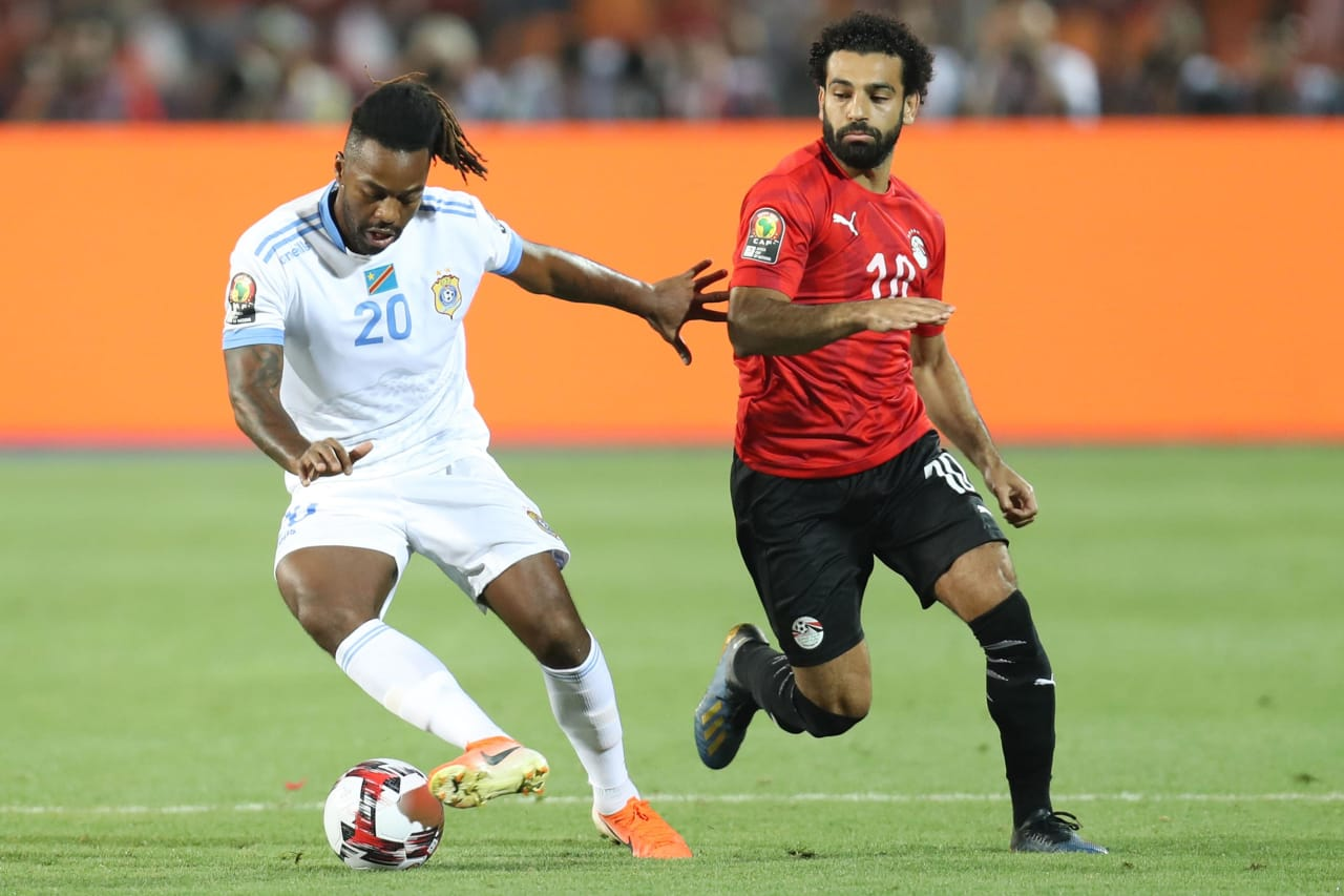 Jacques Maghoma of DR Congo challenged by Mohamed Salah of Egypt during the 2019 Africa Cup of Nations Finals match between Egypt and Dr Congo at Cairo International Stadium, Cairo, Egypt on 26 June 2019 ©Samuel Shivambu/BackpagePix