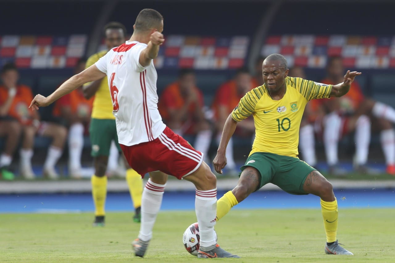 Thulani Serero of South Africa challenged by Ghanem Saiss of Morocco during the 2019 Africa Cup of Nations Finals South Africa and Morocco at Al Salam Stadium, Cairo, Egypt on 01 July 2019 ©Samuel Shivambu/BackpagePix