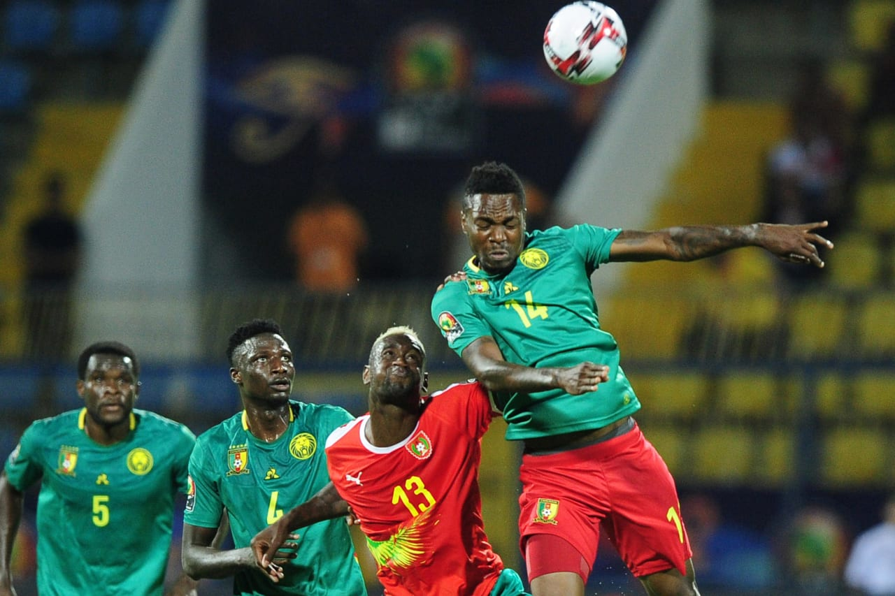 Georges Mandjeck of Cameroon wins the header ahead of Frederic Mendy of Guinea-Bissau during the 2019 Africa Cup of Nations Finals game between Cameroon and Guinea-Bissau at Ismailia Stadium in Ismailia, Egypt on 25 June 2019 © Ryan Wilkisky/BackpagePix
