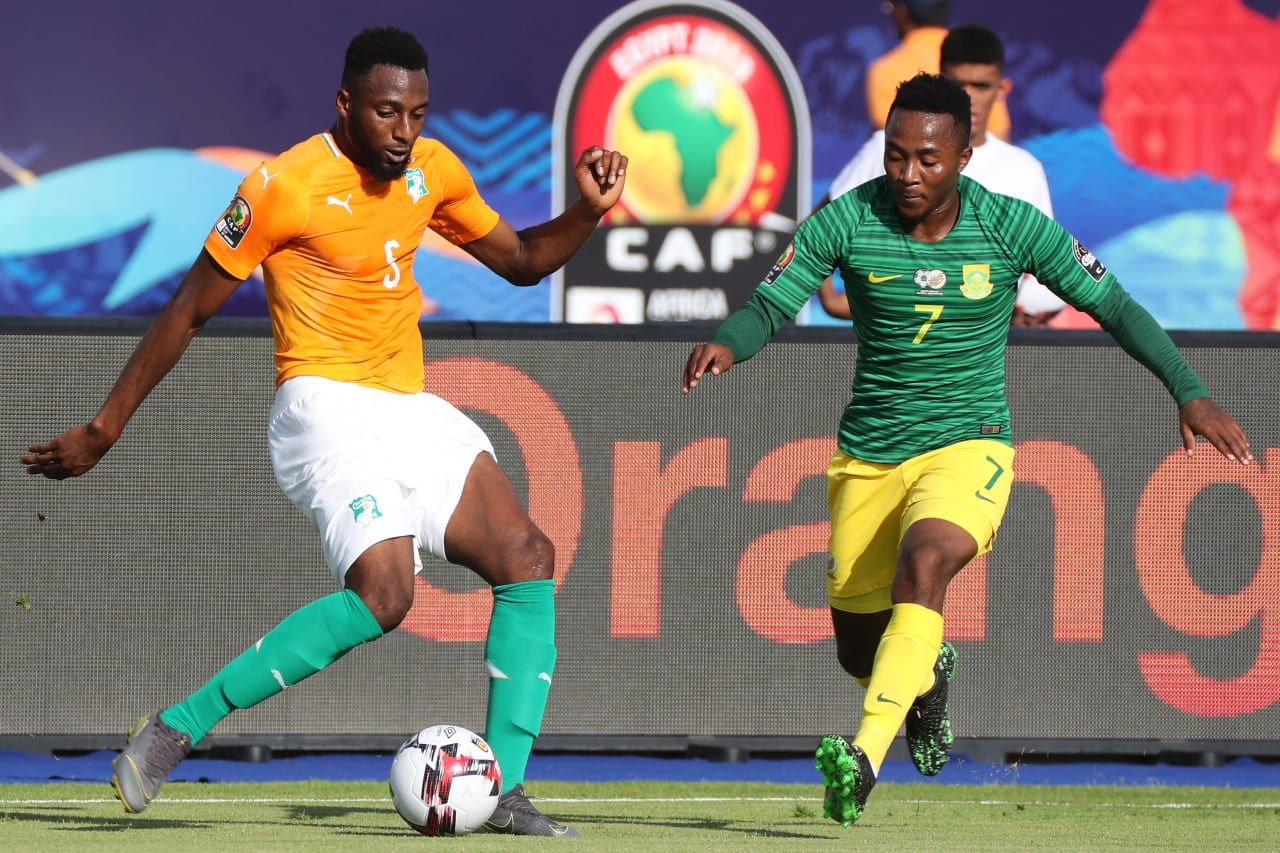 Wilfried Kanon of Ivory Coast challenged by Lebohang Maboe of South Africa during the 2019 Africa Cup of Nations Finals football match between Ivory Coast and South Africa at the Al Salaam Stadium, Cairo, Egypt on 24 June 2019 ©Gavin Barker/BackpagePix