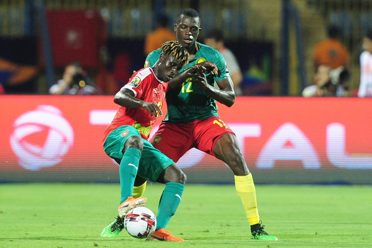 Piqueti Djassi Brito E Silva of Guinea-Bissau is challenged by Joyskim Dawa Tchakonte of Cameroon during the 2019 Africa Cup of Nations Finals game between Cameroon and Guinea-Bissau at Ismailia Stadium in Ismailia, Egypt on 25 June 2019 © Ryan Wilkisky/BackpagePix